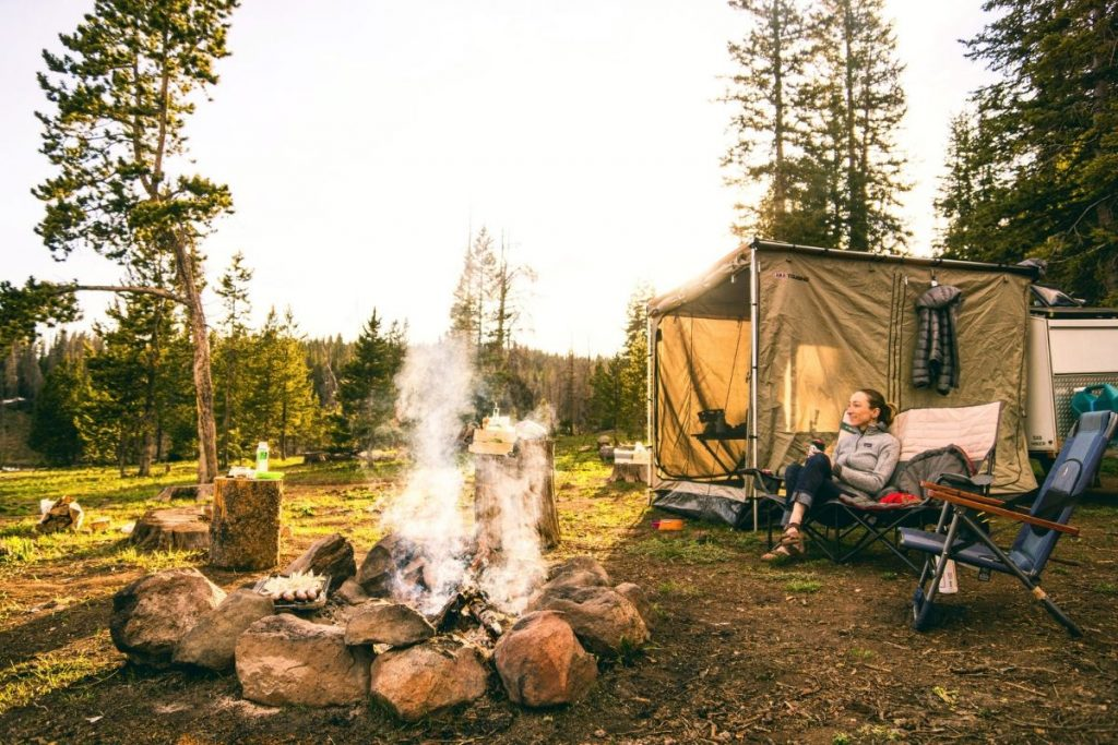 woman relaxing in a camping site
